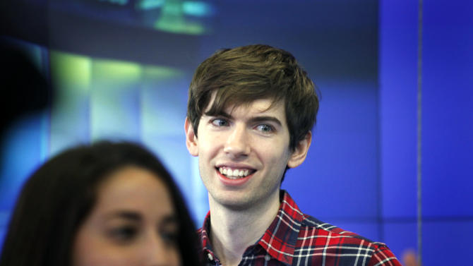 FILE - In this Thursday, July 11, 2013, file photo, David Karp, Founder and CEO of Tumblr, reacts before the opening bell at Nasdaq, in New York. Yahoo's recently completed acquisition of Internet blogging service Tumblr includes an $81 million payment to Tumblr founder David Karp as long as he remains on the job for the next four years. (AP Photo/Mark Lennihan, File)