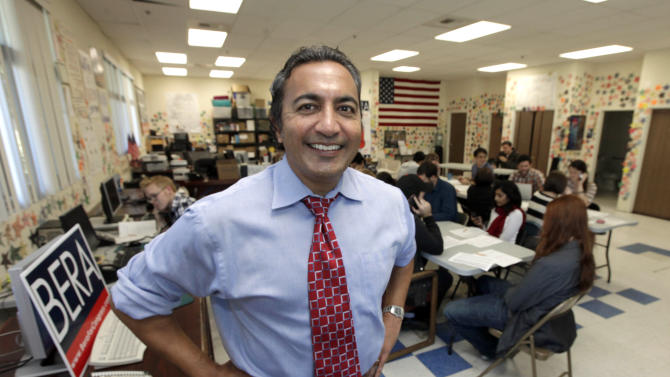 In this Oct. 26, 2012, photo, Ami Bera, the Democratic candidate for the California's 7th Congressional district is seen at his campaign office Elk Grove, Calif.  Bera is challenging incumbent Republican Rep. Dan Lungren. Lungren knows what it's like to have a big bull's eye plastered on his back. The Democratic Party and labor and environmental groups have spent $4.7 million on TV commercials and other efforts to unseat the nine-term Republican congressman from California. The race has attracted large campaign contributions from outside the state. (AP Photo/Rich Pedroncelli)