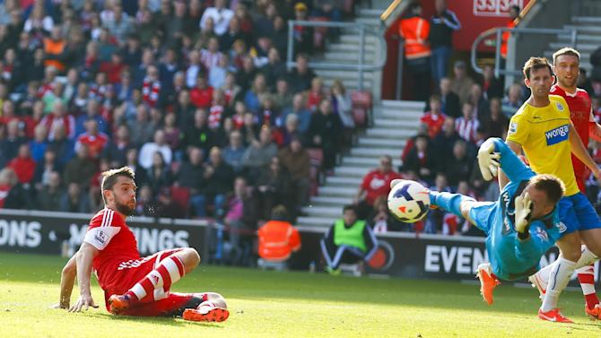Southampton's Jay Rodriguez, left, has his shot saved by Newcastle United's goalkeeper Rob Elliot during their English Premier League soccer match at St Mary's, Southampton, England, Saturday, March 29, 2014