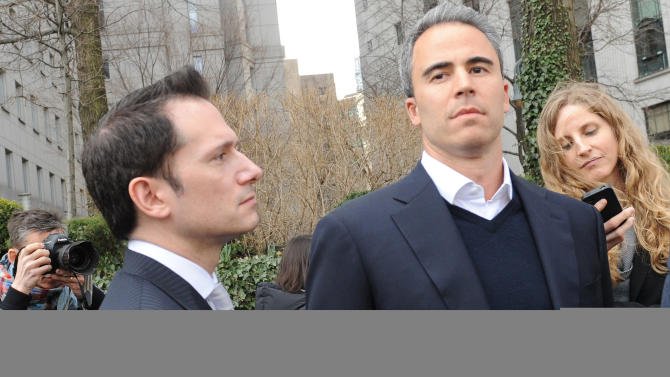 Michael Steinberg, center, exits Manhattan federal court with his attorney Barry Berke, Friday, March 29. 2013, in New York. Stienberg, a senior portfolio manager for SAC Capital Advisors, one of the largest U.S. hedge funds, was arrested Friday, accused of making $1.4 million illegally in a widening insider trading probe involving an investment company founded by billionaire businessman Steven A. Cohen. (AP Photo/Louis Lanzano)