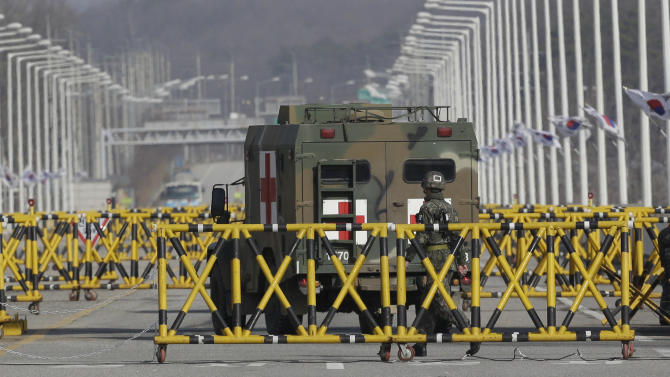 A South Korean military ambulance passes at barricaded Unification Bridge near the border village of Panmunjom, that has separated the two Koreas since the Korean War, in Paju, north of Seoul, South Korea, Tuesday, April 9, 2013. North Korean workers didn't show up for work at a jointly run factory complex with South Korea on Tuesday, a day after Pyongyang suspended operations at the last remaining major economic link between rivals locked in an increasingly hostile relationship. (AP Photo/Lee Jin-man)