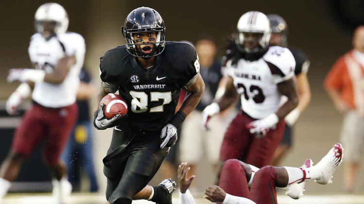 Vanderbilt's Jordan Matthews (87) breaks away from South Carolina's Brison Williams (12) for a touchdown in the first half of an NCAA college football game, Thursday, Aug. 30, 2012, in Nashville, Tenn. (AP Photo/John Russell)