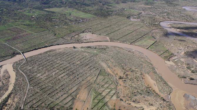 In this photo released by the Philippine Army 10th Infantry Division shows an aerial view of damaged crops caused by flashfloods in Compostela Valley province, southern Philippines on Thursday Dec. 6, 2012. The powerful typhoon that washed away emergency shelters, a military camp and possibly entire families in the southern Philippines has killed hundreds of people with nearly 400 missing, authorities said Thursday. (AP Photo/ Philippine Army 10th ID)