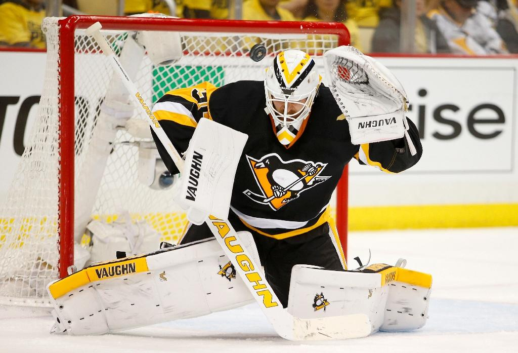 NHL's Murray the hero as Penguins hang on against Capitals