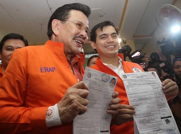 Former President Joseph Estrada and running mate Manila Vice-Mayor Isko Moreno, show their certificates of candidacy for mayor and vice-mayor of Manila respectively, at the Commission on Elections office in Arroceros Street Oct. 2. (Mike Alquinto, NPPA Images)