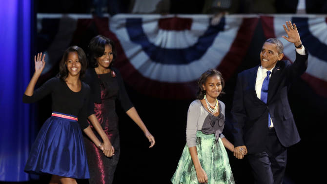 President Barack Obama waves as he walks on stage with first lady Michelle Obama and daughters Malia and Sasha at his election night party Wednesday, Nov. 7, 2012, in Chicago. President Obama defeated Republican challenger former Massachusetts Gov. Mitt Romney. (AP Photo/Chris Carlson)
