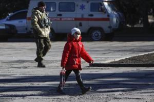 A girl walks across a square in the settlement of Velyka…