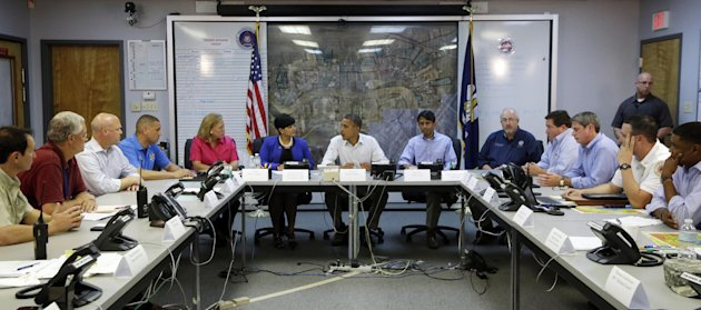 President Barack Obama, center, participates in a briefing with local officials at Saint John Parish Emergency Operations Center (EOC) in LaPlace, La., in Saint John the Baptist Parish, Monday, Sept.