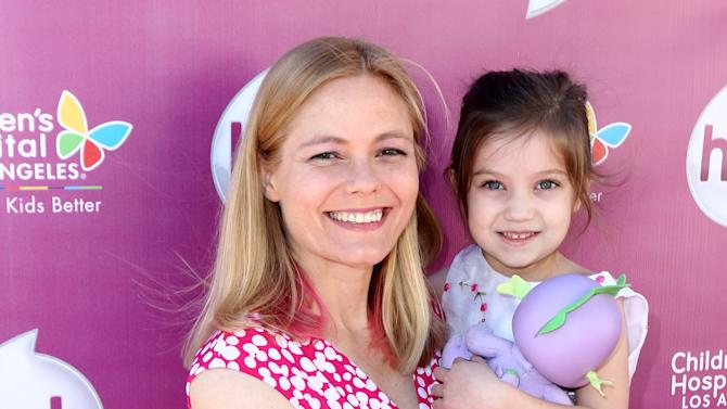 """IMAGE DISTRIBUTED FOR THE HUB - Meghan McCarthy and her daughter Sophie McCarthy attend The Hub TV Network's """"My Little Pony Friendship is Magic"""" Coronation Concert at the Brentwood Theatre on Saturday, Feb. 9, 2013, in Los Angeles in support of Children's Hospital LA. (Photo by Matt Sayles/Invision for The Hub/AP Images)"""