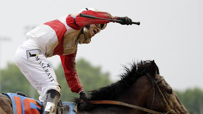 Joel Rosario rides Orb reacts after the 139th Kentucky Derby at Churchill Downs Saturday, May 4, 2013, in Louisville, Ky. (AP Photo/David Goldman)