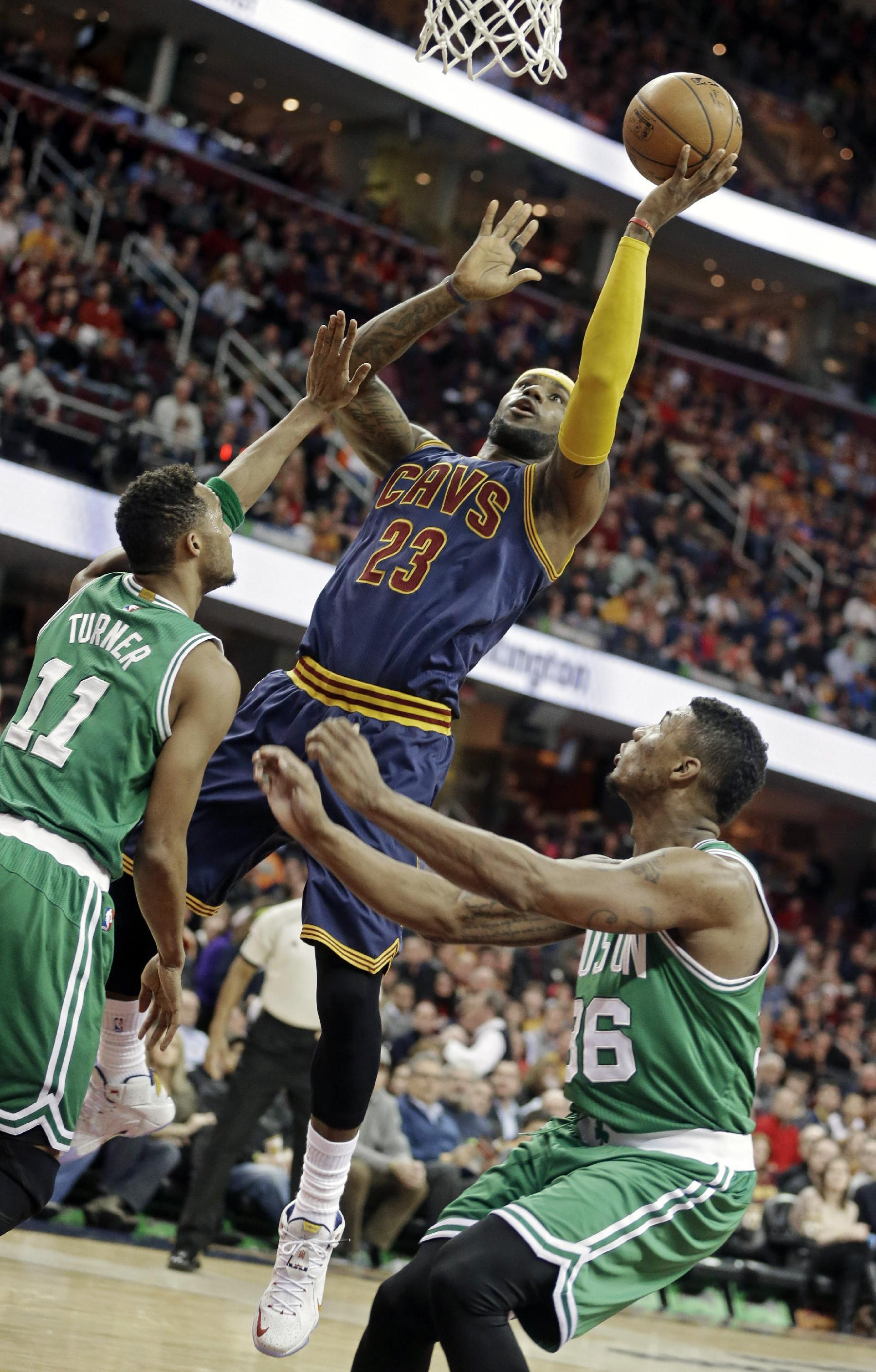 James scores 27 on milestone night, Cavs cruise past Celtics