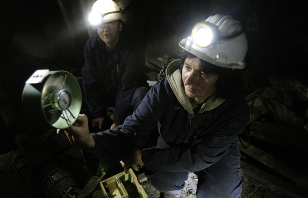 Woemn coal miners Sakiba Colic, left, and Semsa Hadzo, right, Bosnian coal technologists, are checking air flow and temperature at 450 meters underground in the shaft of the coal mine in Breza, 20 kms north of Sarajevo, Bosnia, on Wednesday, Jan. 16, 2013. The mine in Breza is the only one in Bosnia where a group of women work deep underground in the coal mines alongside their male colleagues, a legacy of communism, but they&#39;re set to retire in three years, marking the end of an era for this community where almost everybody is connected to the coal mine. The shafts and elevators echo with laughter and tales of their grandchildren as women miners work alongside their male counterparts.(AP Photo/Amel Emric)