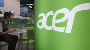 A shop attendant sits in an Acer booth in a computer mall in Taipei