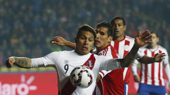 Peru's Guerrero is tackled by Paraguay's Caceres during their Copa America 2015 third-place soccer match at Estadio Municipal Alcaldesa Ester Roa Rebolledo in Concepcion