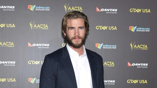 Actor Liam Hemsworth poses at the 2015 G'Day USA Los Angeles Gala honoring actor Chris Hemsworth with an Excellence in Film Award, at the Hollywood Palladium in Los Angeles, California