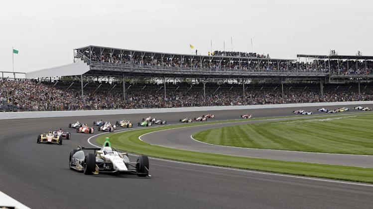 Ed Carpenter leads the field through the first turn at the start of the Indianapolis 500 auto race at Indianapolis Motor Speedway in Indianapolis, Sunday, May 26, 2013. (AP Photo/Tom Strattman)