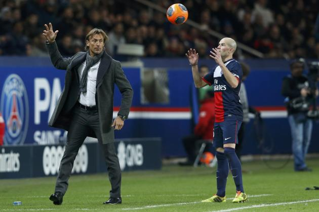 FC Sochaux's coach Renard reacts next to Paris St Germain's Jallet during their French Ligue 1 soccer match at the Parc des Princes Stadium in Paris