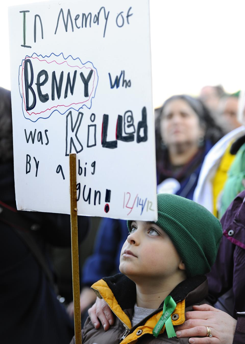 Camron Brant holds a sign during a rally at the Capitol in Hartford, Conn., Thursday, Feb. 14, 2013. Thousands of people turned out to call on lawmakers to toughen gun laws in light of the December elementary school shooting in Newtown that left 26 students and educators dead. (AP Photo/Jessica Hill)
