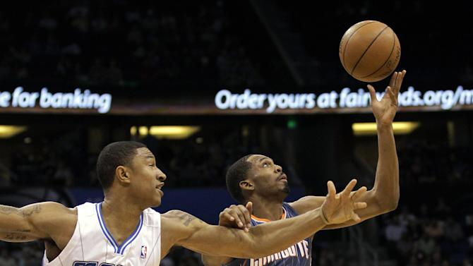 Orlando Magic's Justin Harper (32) and Charlotte Bobcats' Derrick Brown (4) go after the loose ball during the first half of an NBA basketball game, Wednesday, April 25, 2012, in Orlando, Fla. (AP Photo/John Raoux)