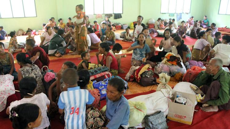 Rakhine refugees take shelter at a camp in Myauk Oo township,  Rakhine State, western Myanmar, Sunday Oct. 28, 2012. Survivors of ethnic clashes in western Myanmar lashed out at the government Monday Oct. 29 2012 for failing to prevent violence between Muslims and Buddhists that has displaced more than 28,000 people over the last week. (AP Photo)