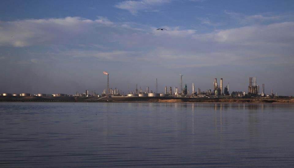 The Amuay refinery is seen near Punto Fijo, Venezuela,Tuesday, Aug. 28, 2012. Venezuela's biggest oil refinery remained offline Tuesday after firefighters extinguished a blaze that raged for more than three days following an explosion that killed at least 41 people. (AP Photo/Ariana Cubillos)