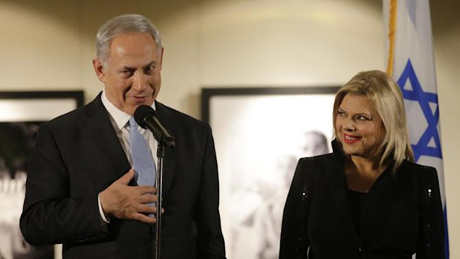 """CORRECTS DAY AND DATE - Israeli Prime Minister Benjamin Netanyahu, accompanied by his wife Sara, right, speaks before the screening of the television documentary """"Israel: The Royal Tour"""" at Paramount Studios on Tuesday, March 4, 2014, in Los Angeles. Netanyahu flew Tuesday from Washington, D.C., to California, trading a focus on the geopolitics of the Middle East for a Hollywood screening and visits with Silicon Valley tech entrepreneurs. (AP Photo/Jae C. Hong)"""