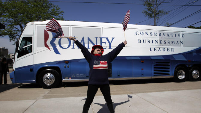 Betty Merrow, 79, cheers for Republican presidential candidate, former Massachusetts Gov. Mitt Romney at a campaign stop in Lansing, Mich., Tuesday, May 8, 2012. (AP Photo/Jae C. Hong)