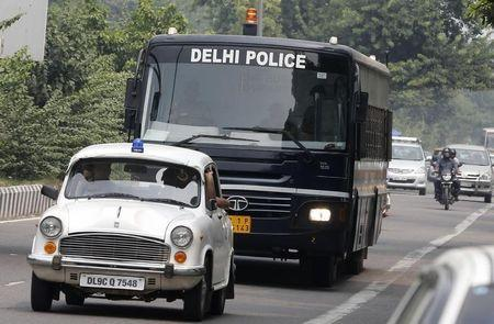A police bus carrying four men who were found guilty of the fatal gang-rape of a young woman on a bus, arrives at a court in New Delhi