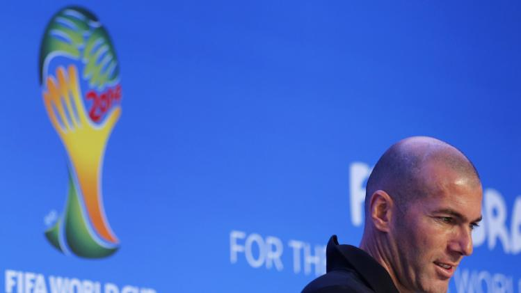 Former French soccer player Zidane arrives to a news conference ahead of the 2014 World Cup draw at the Costa do Sauipe resort in Sao Joao da Mata