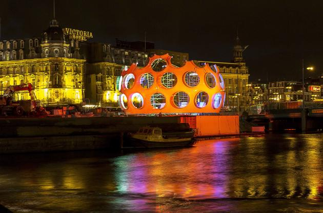 "The orange ""Fly's Eye Dome"" by Buckminster Fuller is pictured on display as part of the Amsterdam Light Festival in Amsterdam"