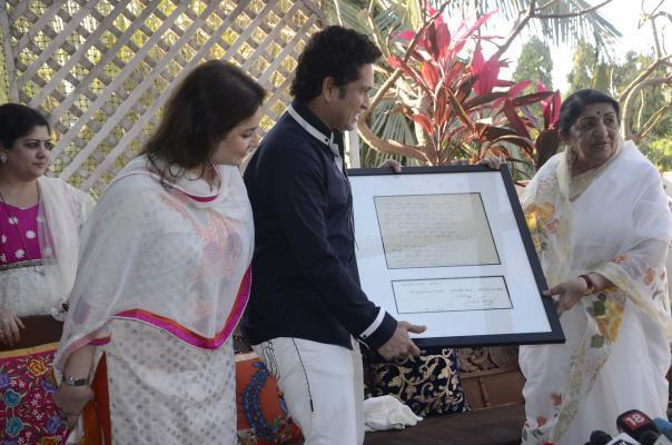 Veteran singer Lata Mangeshkar, cricket legend Sachin Tendulkar and Anjali Tendulkar at MNS Chief Raj Thackeray's residence in Mumbai on March 9, 2014. (Photo: Sandeep Mahankal/IANS)