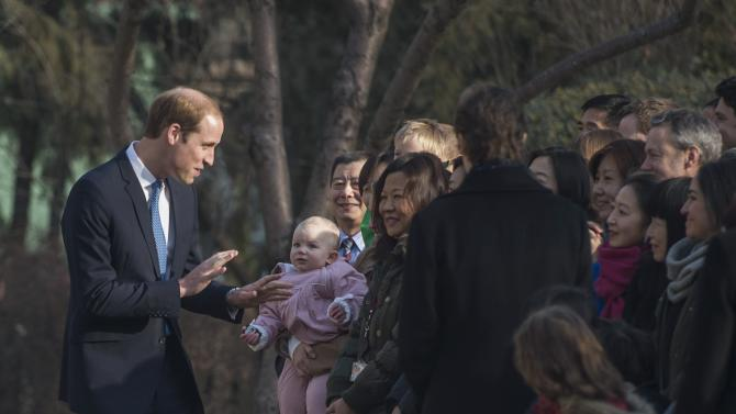 Britain's Prince William, Duke of Cambridge speaks with people at the British Ambassador's official residence in Beijing