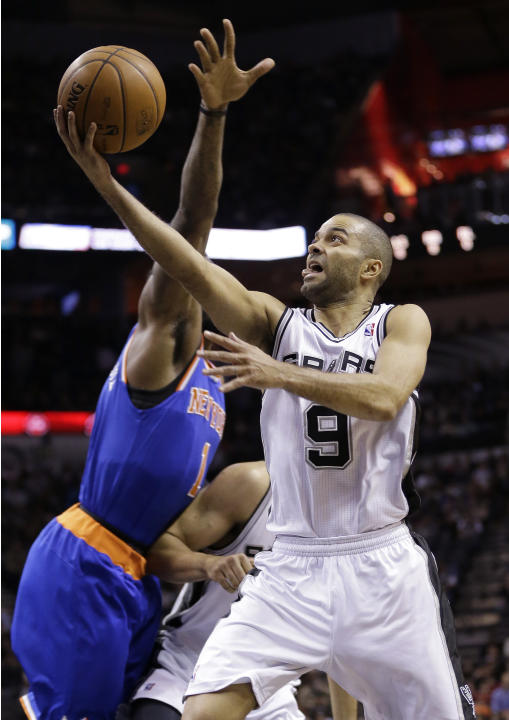 San Antonio Spurs' Tony Parker (9), of France, shoots past New York Knicks' Amare Stoudemire (1) during the first half on an NBA basketball game, Thursday, Jan. 2, 2014, in San Antonio. (AP Ph