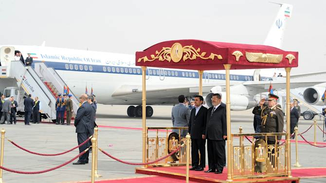 In this image released by the Egyptian Presidency, Iran's President Mahmoud Ahmadinejad, center, and Egyptian President Mohammed Morsi, center right, participate in an arrival ceremony at the airport in Cairo, Egypt, Tuesday, Feb. 5, 2013. Ahmadinejad arrived in Cairo on Tuesday for the first visit by an Iranian leader in more than three decades, marking a historic departure from years of frigid ties between the two regional heavyweights.(AP Photo/Egyptian Presidency)