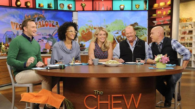 "This Sept. 17, 2013 photo shows the hosts of ""The Chew,"" from left, Clinton Kelly, Carla Hall, Daphne Oz, Mario Batali and Michael Symon in the studio in New York. When ABC's ""The Chew"" premiered in September 2011, it begged the question: Was it biting off more than it could chew? Maybe not. On Tuesday in its regular 1 p.m. EST time slot, ""The Chew"" marks its 500th edition. (AP Photo/ABC, Jeff Neira)"