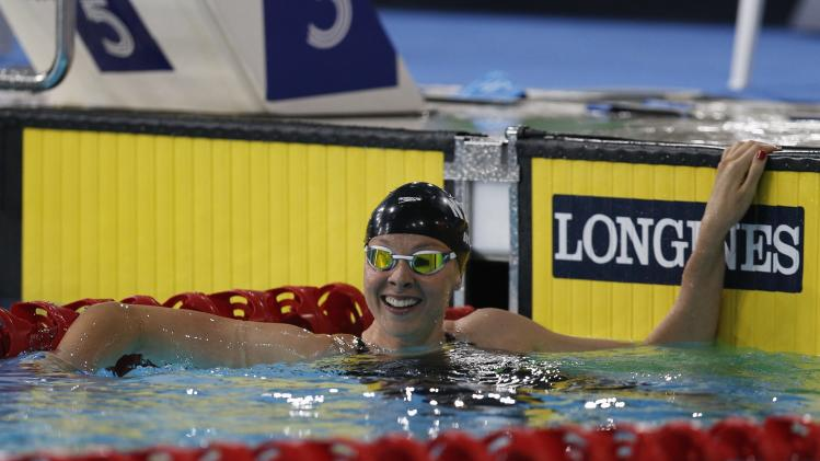 New Zealand's Lauren Boyle reacts after winning the women's 400m freestyle during the 2014 Commonwealth Games in Glasgow