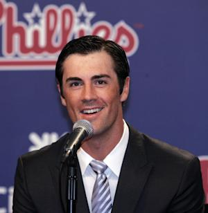 Philadelphia Phillies pitcher Cole Hamels answers a question during news conference Wednesday, July 25, 2012, in Philadelphia. Hamels and the Phillies have agreed to a $144 million, six-year contract that prevents the 2008 World Series MVP from becoming a free agent after the season. (AP Photo/Tom Mihalek)