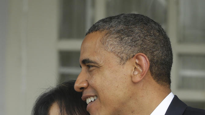 U.S. President Barack Obama, right, and Myanmar opposition leader Aung San Suu Kyi walk out together after addressing members of the media at Suu Kyi's residence in Yangon, Myanmar, Monday, Nov. 19, 2012. Obama who touched down Monday morning, becoming the first U.S. president to visit the Asian nation also known as Burma, said his historic visit to Myanmar marks the next step in a new chapter between the two countries. (AP Photo/Pablo Martinez Monsivais)