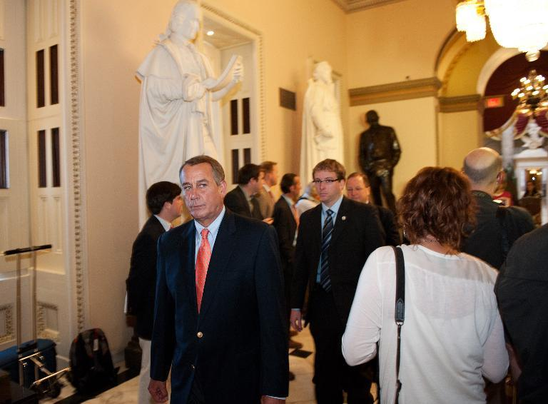 US House Speaker John Boehner (C), Republican of Ohio, walks through a corridor on October 5, 2013 at the US Capitol in Washington, DC