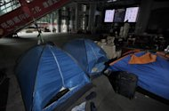 Tents and belongings of the anti-capitalist Occupy movement in Hong Kong stand at the ground level of the HSBC building in Hong Kong. HSBC said it has launched legal action in a bid to end the anti-capitalist Occupy movement in Hong Kong, where the protesters have camped out at its building for eight months