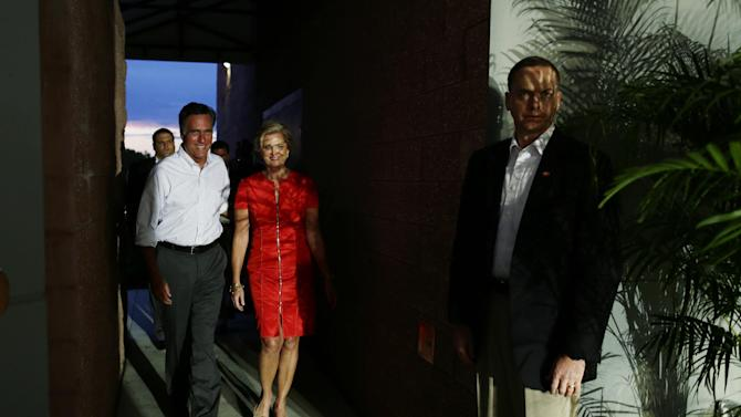 Republican presidential candidate and former Massachusetts Gov. Mitt Romney and his wife Ann walk backstage before his campaign appearance in Apopka, Fla. on Saturday, Oct. 6, 2012. (AP Photo/Charles Dharapak)