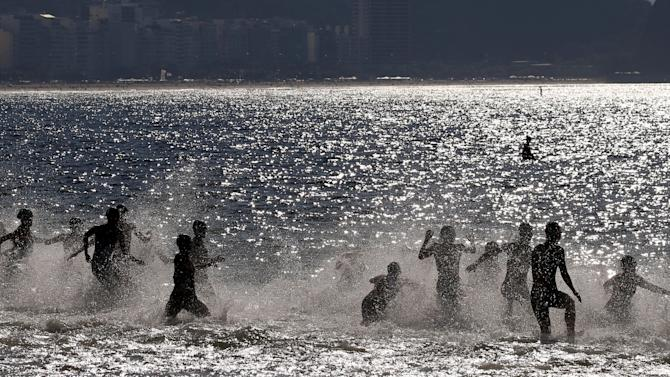 Athletes start of the swimming leg of the women's triathlon at the ITU World Olympic Qualification event on Copacabana beach in Rio de Janeiro