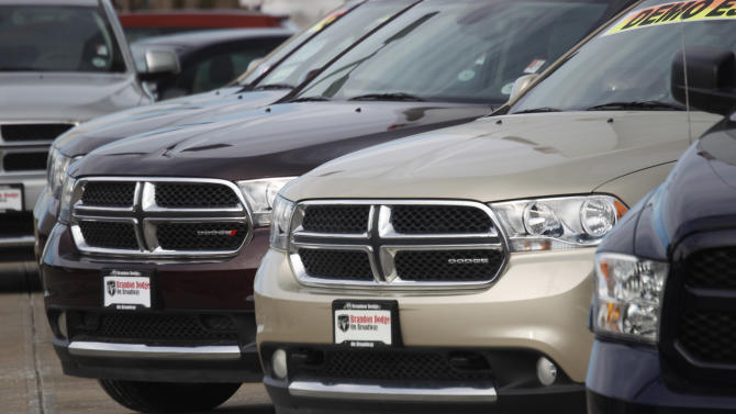 FILE - In this Sunday, Jan. 20, 2013, file photo, a line of unsold 2012 Durango sports-utility vehicles sits at a Dodge dealership in Littleton, Colo. Fiat Chrysler is adding more than 467,000 Dodge and Jeep SUVs worldwide to a 2014 recall to fix a potential stalling problem. The company says it's adding 2012 and 2013 Dodge Durangos and 2011 Jeep Grand Cherokees outside North America to a recall from September of last year. The Jeeps have diesel engines. (AP Photo/David Zalubowski, File)