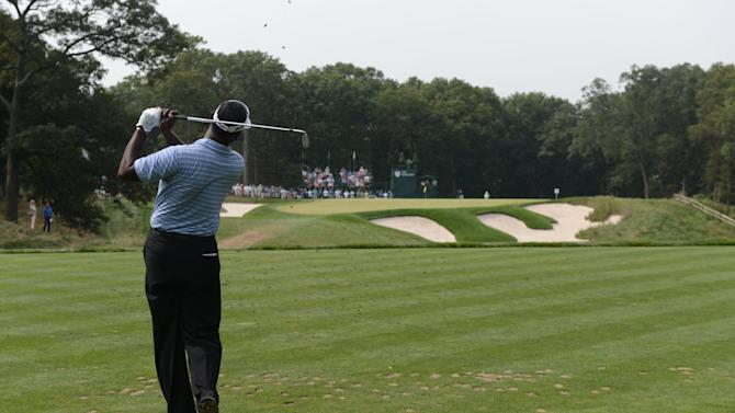 Vijay Singh,  of Fiji,  hits his tee shot on the 14th hole during the second round of The Barclays golf tournament at Bethpage State Park in Farmingdale, N.Y., Friday, Aug. 24, 2012. (AP Photos/Henny Ray Abrams)