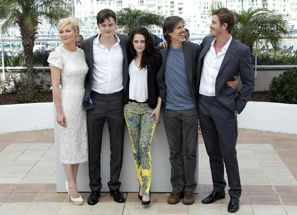 From left actors, Kirsten Dunst, Sam Riley, Kristen Stewart, director Walter Salles and actor Garret Hedlund pose during a photo call for On the Road at the 65th international film festival, in Cannes, southern France, Wednesday, May 23, 2012. (AP Photo/Joel Ryan)