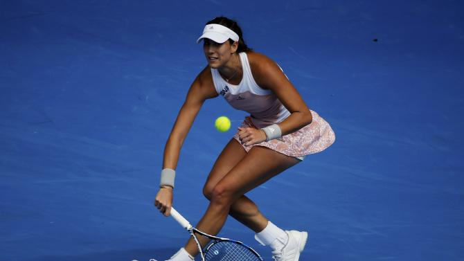 Muguruza of Spain hits a return to Williams of the U.S. during their women's singles fourth round match at the Australian Open 2015 tennis tournament in Melbourne