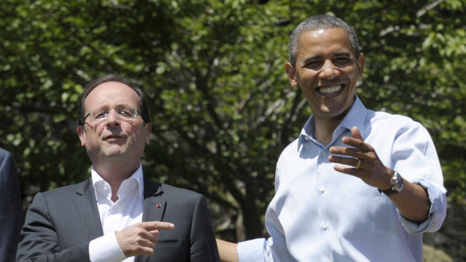 In this May 19, 2012 file photo, French President Francois Hollande, left, answers a question with President Barack Obama during a photo opportunity at the G-8 Summit at Camp David, Md. France's suddenly single president arrives Monday Feb. 10, 2014 in the U.S. for a state visit, hoping the glaring absence of his first lady won't steal the limelight from his focus on major policy issues with President Barack Obama. Hollande will be highlighting France's shared interests with Washington on issues like Syria's civil war, Iran's nuclear program and terrorism in Africa. (AP Photo/Susan Walsh, File)