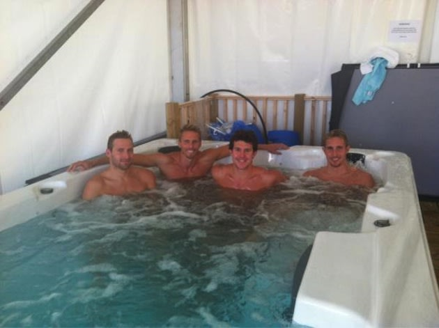 Graeme Moore and his South African swim 'bros' chill out in an ice bath — Twitter