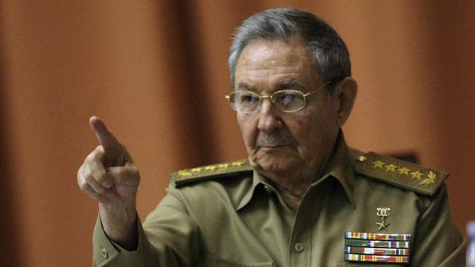 Cuba's President Raul Castro points as he attends a session of the National Assembly in Havana, Cuba, Thursday, Dec. 13, 2012. The session is one of the National Assembly's twice-yearly gatherings. (AP Photo/Ismael Francisco, Cubadebate)