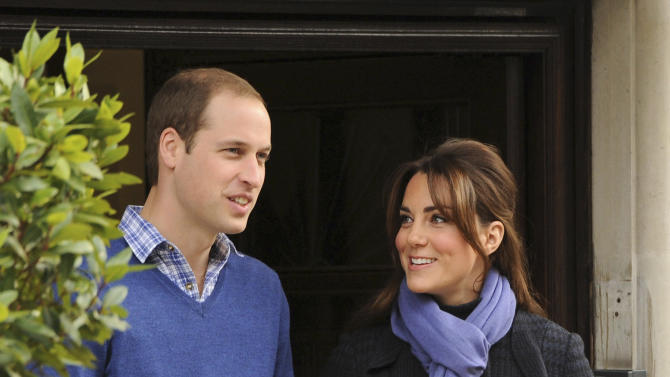 Britain's Prince William stands next to his wife Kate, Duchess of Cambridge as she leaves the King Edward VII hospital in central London, Thursday, Dec. 6, 2012. Prince William and his wife Kate are expecting their first child, and the Duchess of Cambridge has been admitted to hospital suffering from a severe form of morning sickness in the early stages of her pregnancy. (AP Photo/Andrew Matthews)